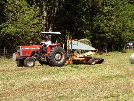 Tractor wrapping round bale 1