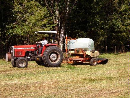 Tractor wrapping round bale 2